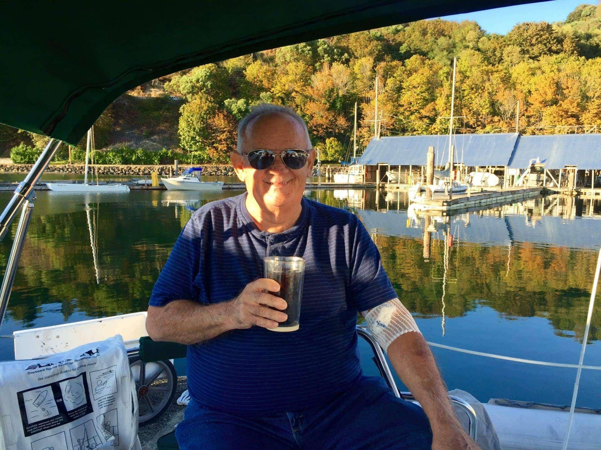 Dick enjoying a drink in Grace's cockpit.