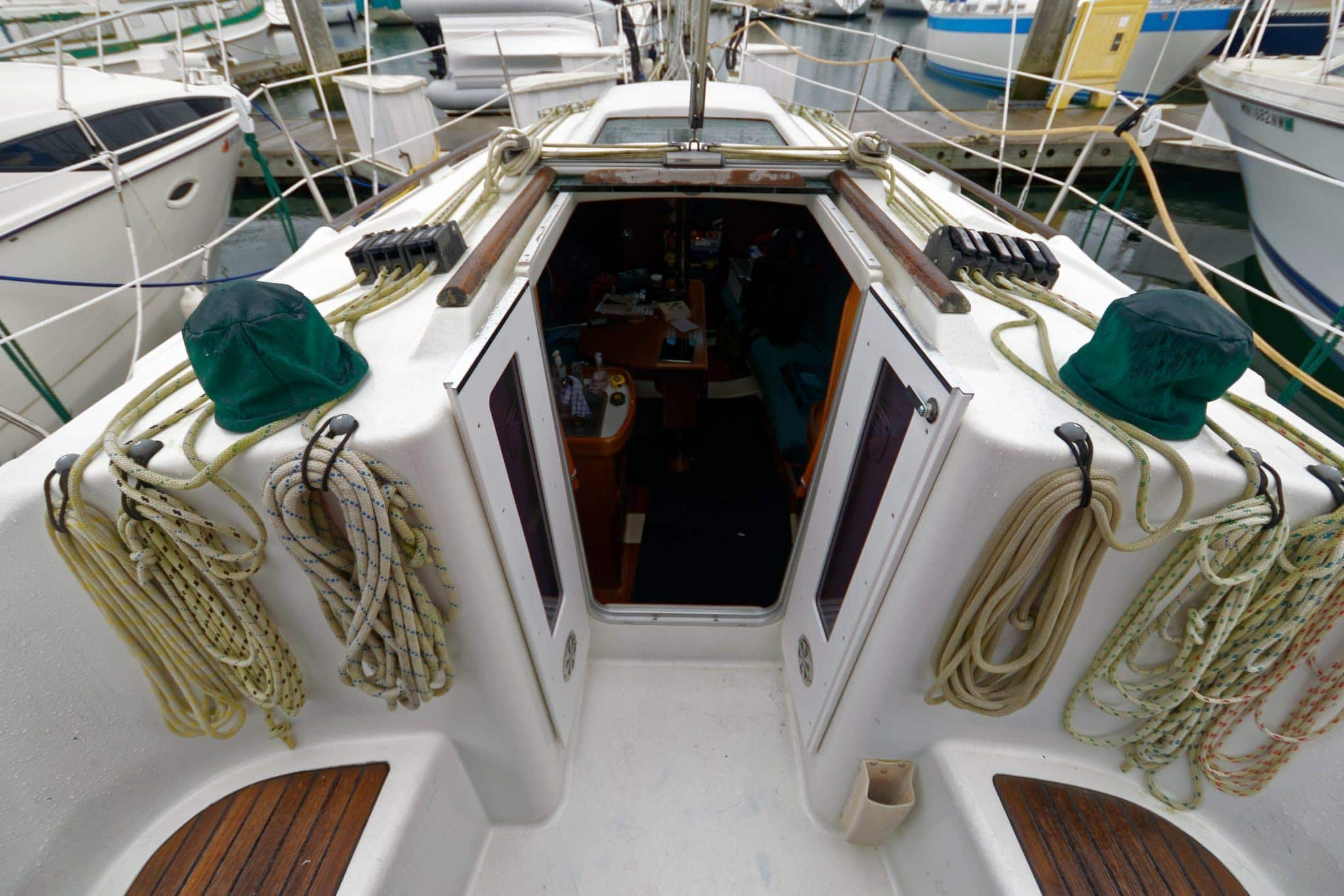 Doors open easily and fold against the companionway