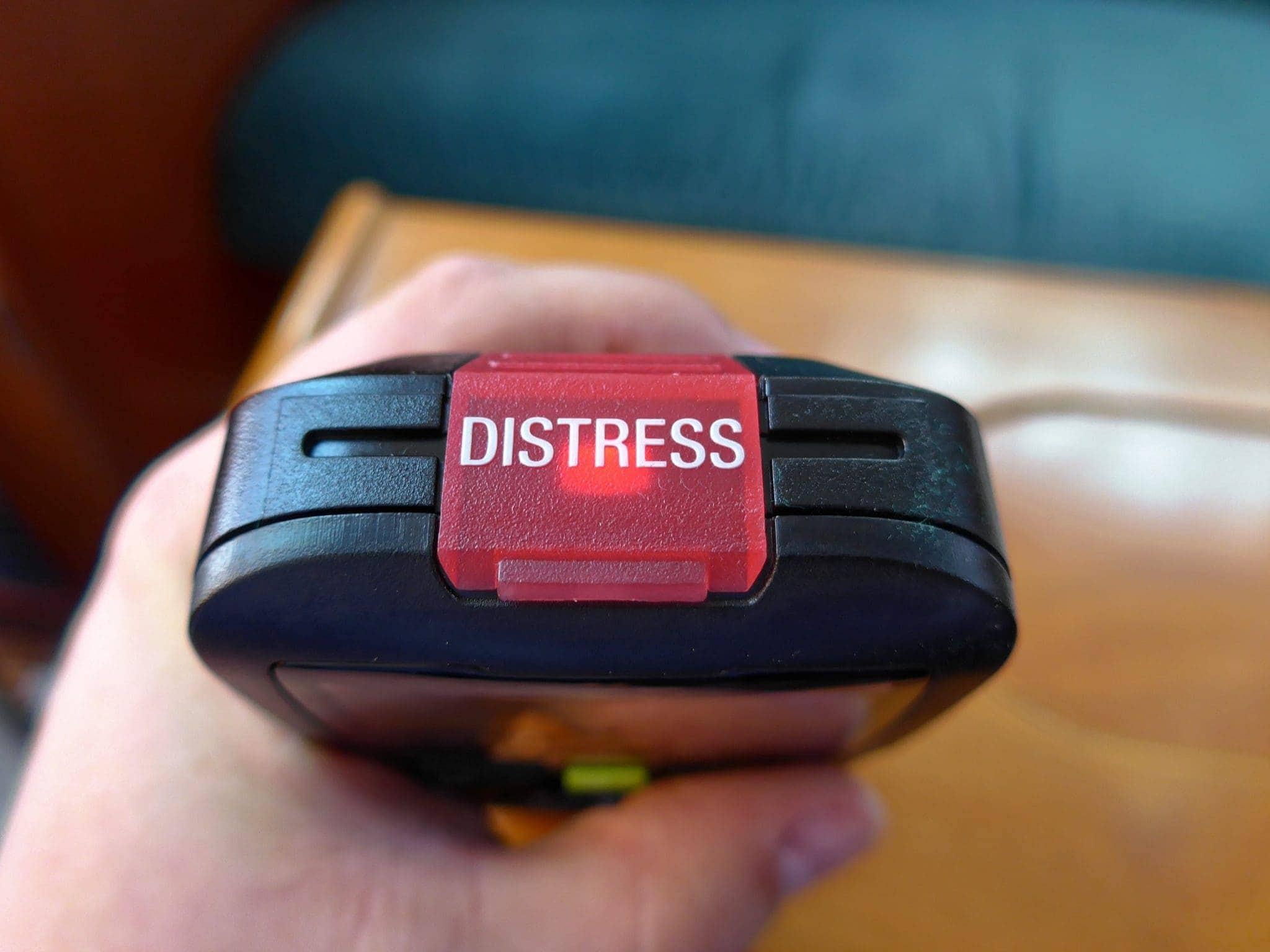 Top showing lit distress button