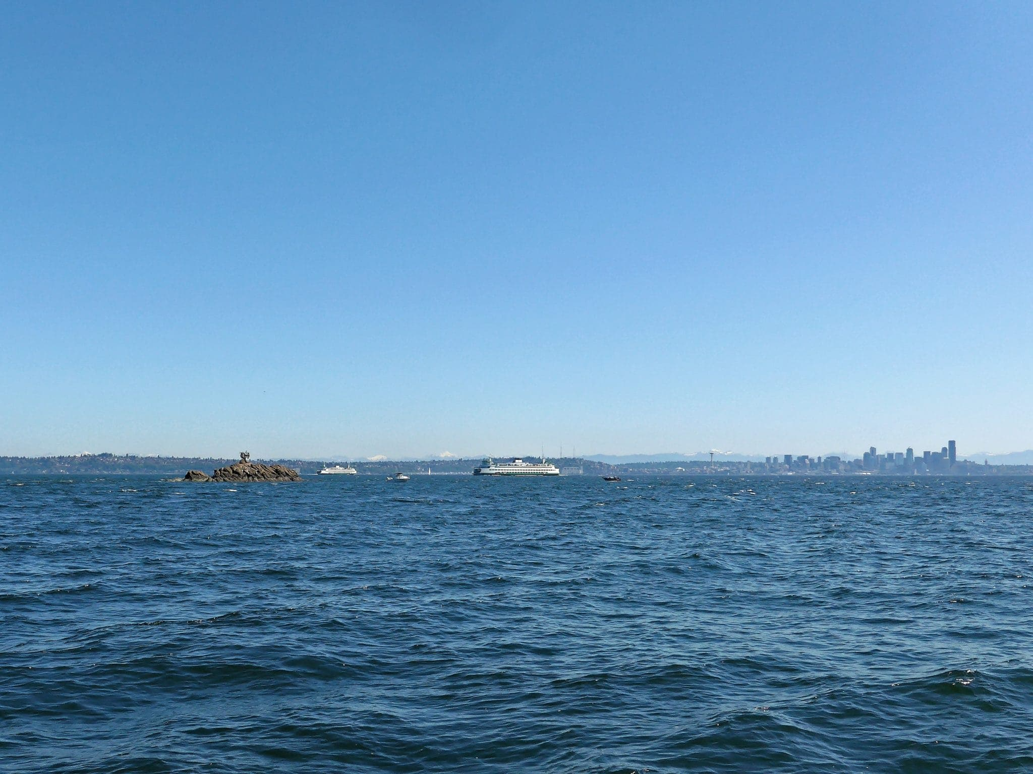 Blakeley Rocks with Bainbridge Ferries in background and Seattle